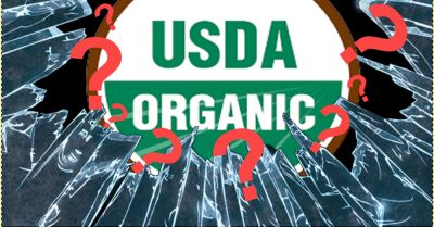 USDA organic seal under broken glass with red question marks