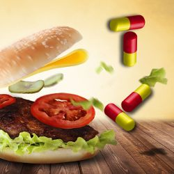 burger with flying ingredients surrounded by pill capsules