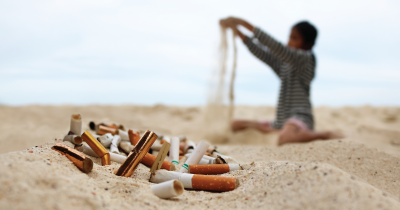 Cigarettes in the sand.