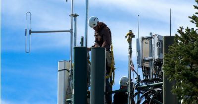 person working on a cellular telephone tower