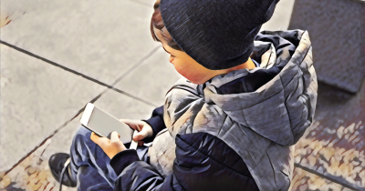 Child with cellphone.