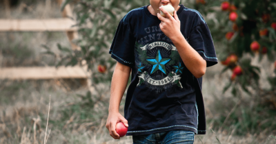 Apple being eaten by a kid.