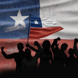 Chilean protesters and supporters waving a Chilean flag