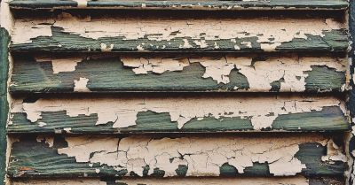 Old chipping and peeling paint from a window shutter