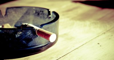 cigarette burning in an ashtray