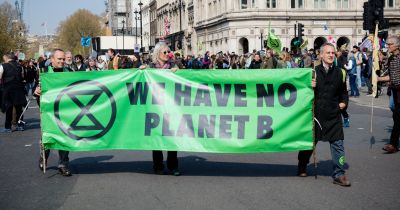 many people marching in the street protesting climate change