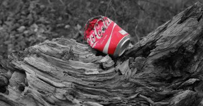 crushed coca cola soda pop can litter