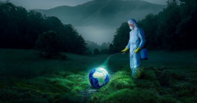 person disinfecting the globe for covid-19