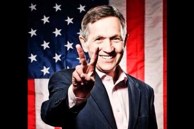 Dennis Kucinich in front of an American Flag