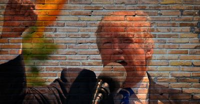 Donald Trump giving a speech projected on a brick wall