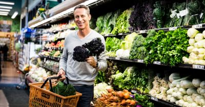 Dr Mark Hyman shopping in the produce section of a co op