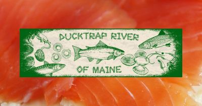 Ducktrap River of Maine logo in front of smoked salmon