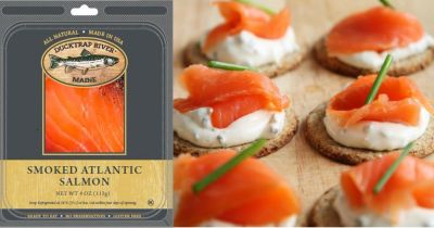 Ducktrap brand smoked salmon packet near a set of salmon canape appetizers