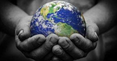 hands holding a planet Earth