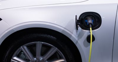 white electric car charging