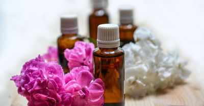 brown glass essential oil tincture bottles with purple and white flowers