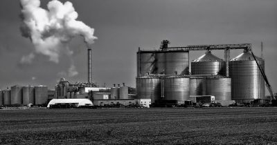 ethanol plant with farm field in foreground