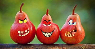 Three red pears with cartoon evil faces
