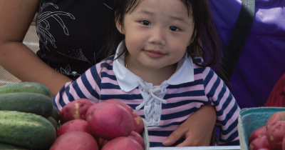 Child at farmers market.