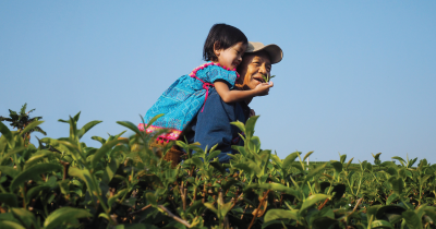A farmer father and child.