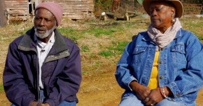African American farmers sitting outside on their farm in North Carolina