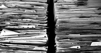 stacks of business papers and files