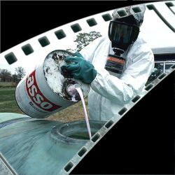 film strip section showing a person in hazmat suit pouring Monsantos Lasso into a tank