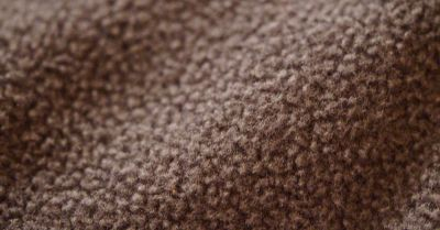 tan textured fleece fabric swatch of a textile