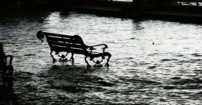 flooded park bench in black and white