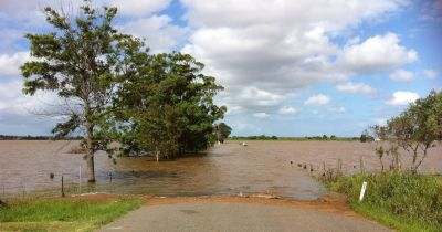 Rural road entering flooded area