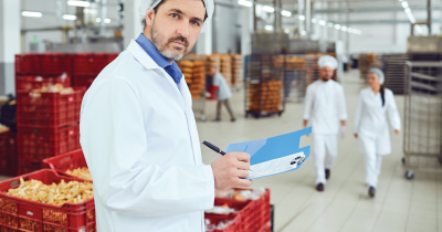 Person checking food safety in a meat plant.