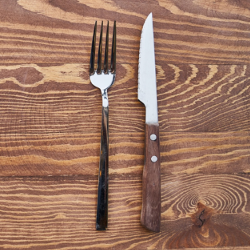 fork and knife on a wooden table