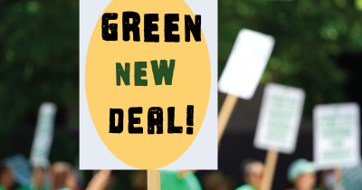 yellow and green sign being held during a march that supports the GREEN NEW DEAL