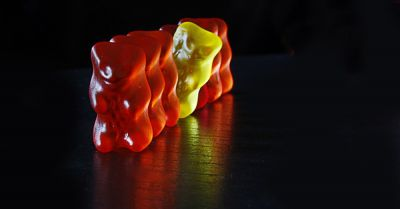 red and yellow gummy bear candies in a line