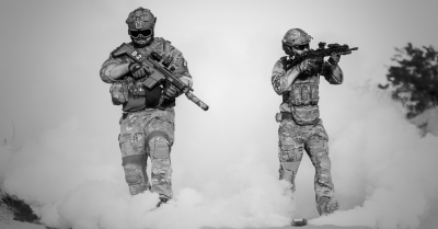Two guys with guns and tear gas