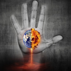 A hand with the earth, half on fire, in front of it