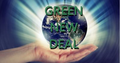 hand holding a small bright planet earth with the words GREEN NEW DEAL