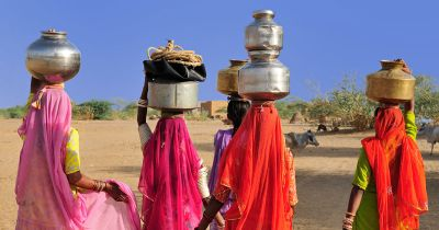 People carrying water.