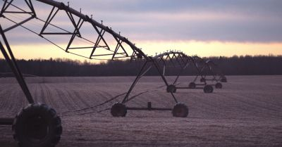 industrial farming irrigation equipment on a crop field
