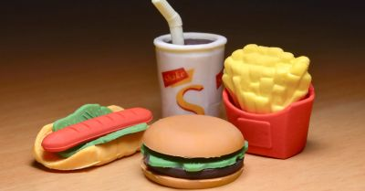 plastic toy set of a junk food meal containing a hot dog hamburger fries and a shake