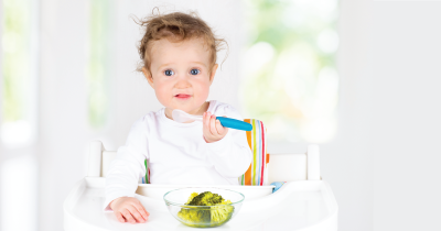 Child eating veggies.