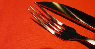 knife and fork cutlery on an orange background
