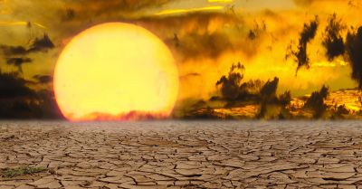 landscape of drought ridden soil at sunset