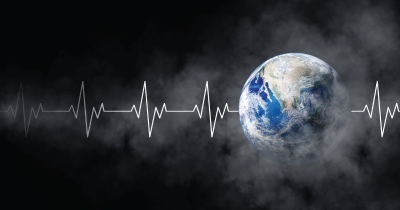 Planet earth on black background with heartbeat graph