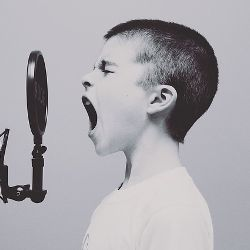 Child yelling into a radio microphone