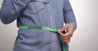 person measuring weight