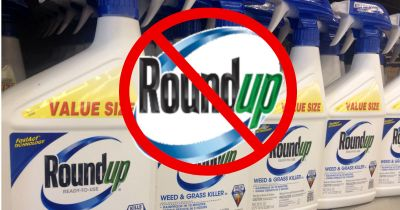 red circle with slash through Monsantos glyphosate herbicide ROUNDUP logo
