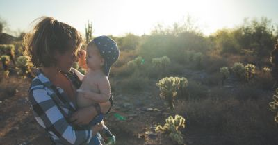 mother and child in the desert landscape at sunset