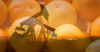 silhouette of an oil drill superimposed over oranges