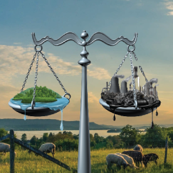 scales of pollution and clean environment against a backdrop of sheep grazing in a field